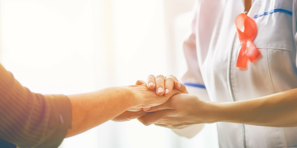 Nurse touching patient hand for High Touch