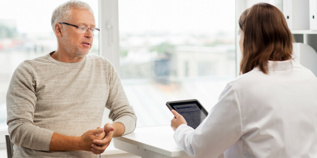Man and Doctor talking about appointment using an iPad for High Tech